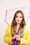 Woman wearing waterproof coat holding umbrella Stock Photos