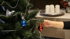 Outweigh Christmas ball from one branch to another, on the background of Stock Footage