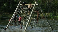 Obstacle course race in the water - climbing ropes Stock Footage