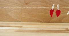 Figurine kneeling in front of broken heart Stock Footage