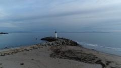 Aerial view of Santa Cruz Walton lighthouse near Pacific coast, California Stock Footage