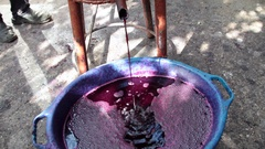Fermenting wine pouring from a traditional wine press  Stock Footage