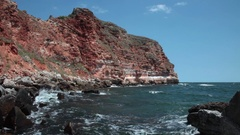 Beautiful red cliffs edging the coastline of Bulgarian Black Sea, rocky canyon Stock Footage