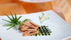 Exotic dishes on white porcelain. Stock Footage