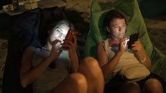 Two young girlfriends using smartphone in outdoor cafe, 4K Stock Footage