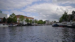 Scenic View Of Canal, From Motor Boat, Amsterdam, Netherlands Stock Footage