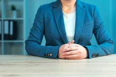 Business negotiation skills with female executive at office desk Stock Photos