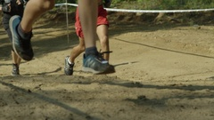 Slow motion group of runners feet in race Stock Footage