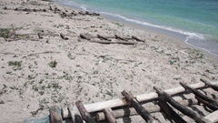 Artisanal wooden boat ramp on a sunny beach Stock Footage
