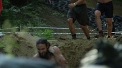 Slow motion male athletes racing obstacle course - fitness competition Stock Footage
