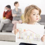 Anxious boy with arguing parents Stock Photos