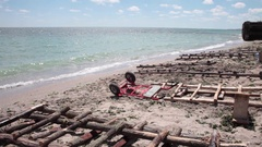 Vintage wooden ramps for artisanal rowboats on the beach Stock Footage