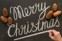 Merry Christmas hand writes on the chalk board. Stock Photos
