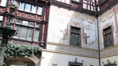 Inner courtyard of Neo-Renaissance castle with ornate timber framing and murals Stock Footage