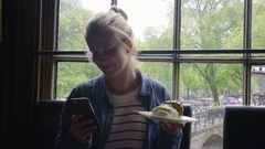 Adventurous Young Woman Takes Photos Of Her Dessert (In Amsterdam), Takes A Bite Stock Footage