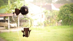 Decorative mobile hanging with rainy day background Stock Footage