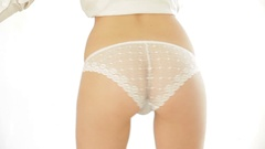 Young woman in white panties isolated on white background Stock Footage