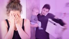 Wife suffering from postpartum depressionn Stock Photos