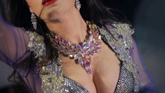 View of breast and neck of belly dancer during dance Stock Footage
