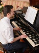 Portrait of music performer playing his piano Stock Photos