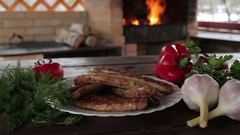 Appetizing grilled sausages with vegetables on a plate Stock Footage