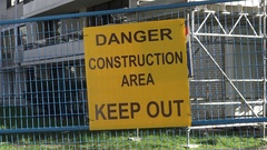 Danger construction area signage on site Stock Footage