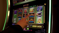 Close up people playing slot machine inside Hard Rock Casino Stock Footage