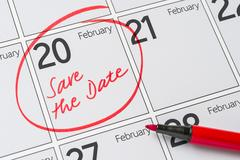 Save the Date written on a calendar - February 20 Stock Photos