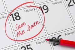 Save the Date written on a calendar - February 18 Stock Photos