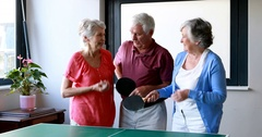 Senior citizen standing interacting with each other Stock Footage