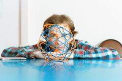 Young Man And The Volumetric Model Of Geometric Solid Stock Photos