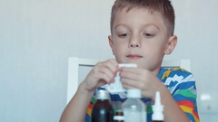 Little boy with medicine Stock Footage