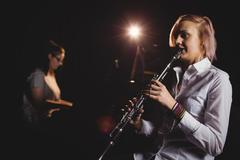 Two female students playing clarinet and piano Stock Photos
