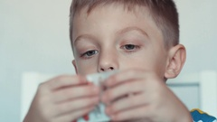 Little boy and pills,vitamin C Stock Footage