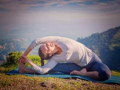 Young sporty fit woman doing Hatha Yoga asana Stock Photos