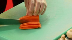The chef cuts the carrot. Stock Footage
