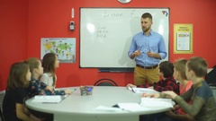 The teacher welcomes the students in the classroom Stock Footage