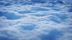 Moving Over Snow With Grass Shoots Poking Through Stock Footage