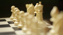 Chess board with white pieces Stock Footage