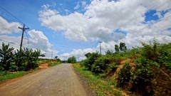 Motion along Country Road to Skyline past Forestry Hilly Slopes Stock Footage