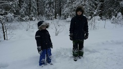 Slow motion of two boys having fun in the snow, Full HD footage Stock Footage