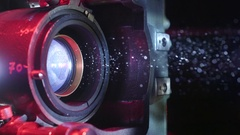 70mm Film Projector Lens With Dust In Beam Stock Footage