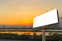 Blank billboard at twilight time ready for new advertisement Kuvituskuvat