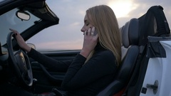 The woman driving the car talking on the phone Stock Footage