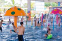 Blurred of Child having fun in swimming pool. Summer vacation and healthy l.. Stock Photos