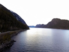 Landscape with big lake and car drive on road Stock Footage