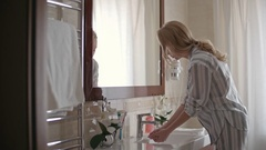Woman Cleaning Hands in Bathroom Stock Footage