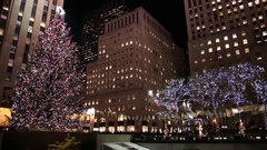 People skating on the ice rink at Rockefeller Center during Christmas epoch Stock Footage