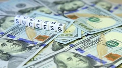 "Word from cubes ""success"" on the spinning surface of American dollars. Stock Footage"
