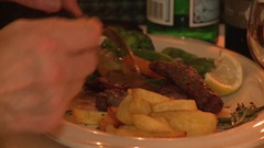 Group of people eating at restaurant table Stock Footage